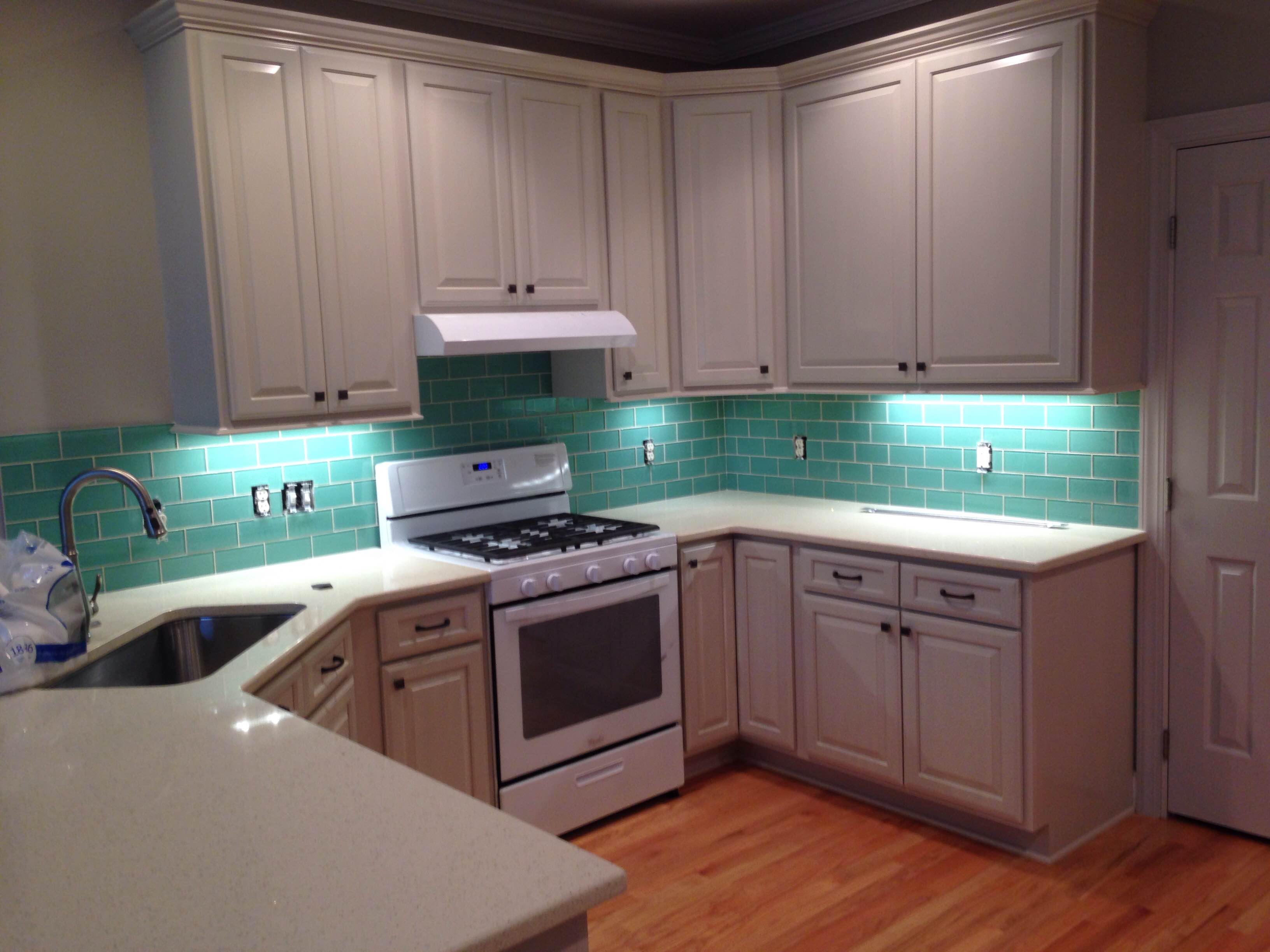 white kitchen cabinets with under-cabinet lighting triangle cabinet cures