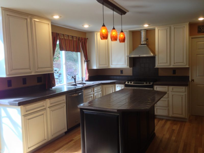 dark tiled counters with white kitchen cabinets triangle cabinet cures