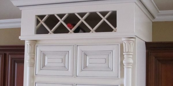 white crown molding triangle cabinet cures