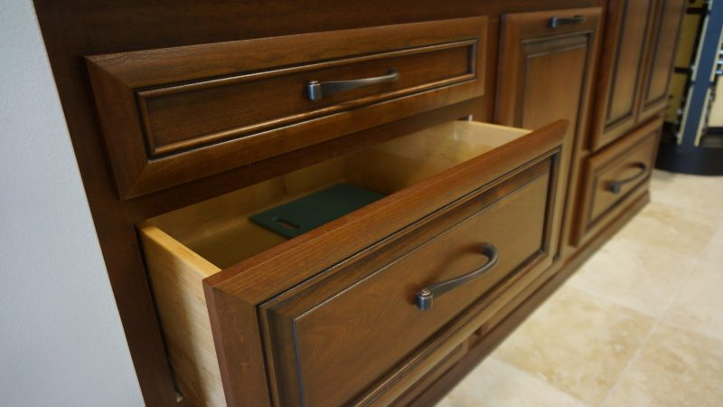 raised panels brown drawers triangle cabinet cures