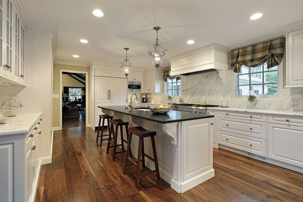 white corbels white kitchen cabinets black and white granite countertops triangle cabinet cures