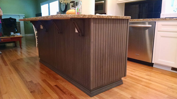 brown mission corbels beaded kitchen island triangle cabinet cures