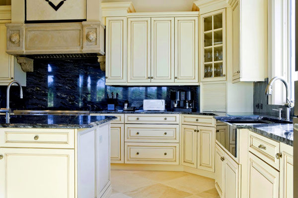 stone stove corbels yellow kitchen cabinets black granite countertops and backsplash triangle cabinet cures